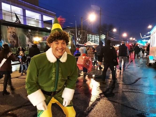 Lakewood's Buddy Elf strikes a pose during the Light Up Lakewood parade.