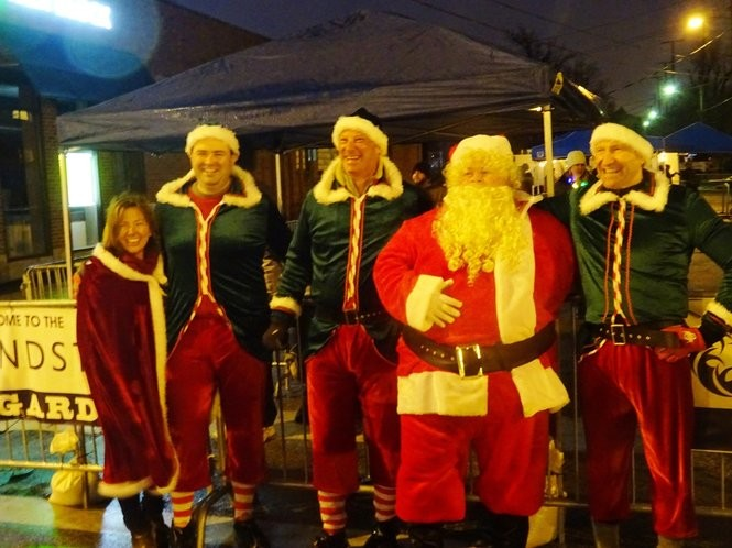 Santa and some of his helpers take a break after marching in the parade.