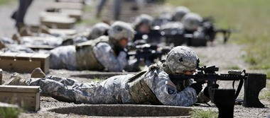 Women of the 1st Brigade Combat Team, 101st Airborne Division, train on the firing range at Fort Campbell, Ky.