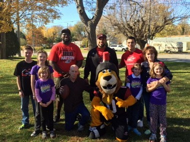 """The Cleveland Gladiators are supporters of the Meadows Turkey Bowl. Several folks associated with the team are shown with Wendy and John Bigelow and their children. """"It's funny the paths you take in life,"""" Wendy says."""