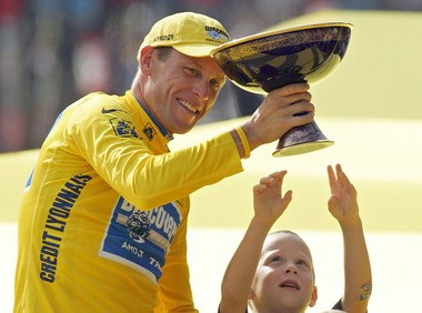 Lance Armstrong's son, Luke, tries to touch the Tour de France trophy his father had won in 2005. Armstrong last week came clean that he had used performance-enhancing drugs, after years of denying the claims.