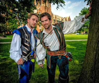 Providing entertainment at Art on the Circle were Dusten Welch, left, of Lakewood, and Steve Madden, a resident of Broadview Heights. Together, the humorous sword fighters are known as The Dueling Fools. The Notre Dame College Administration Building in the background makes for a nice, time-appropriate backdrop for such medieval-era swordsmen.