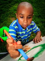 Caleb Wright, 5, decides to get in on the act at Art on the Circle. Caleb is in first grade and lives in South Euclid.