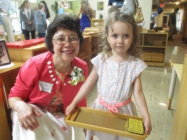 Montessori School of University Heights Head of School Maria Wood and student Mary Stachowiak, 3, of Cleveland Heights.