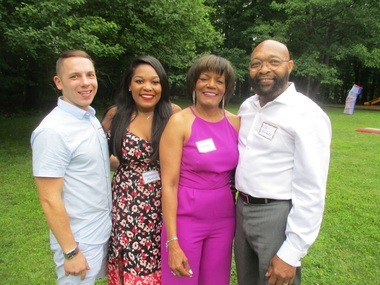 Melissa Munford, second from left, attended Montessori School of University Heights from 1989-93. Her mother, Brenda, pictured next to her, is a teacher at the school. At far right is Melissa's father, J.C. Munford, of Cleveland, and, at far left, her boyfriend, John Mrosko, of Cuyahoga Falls.