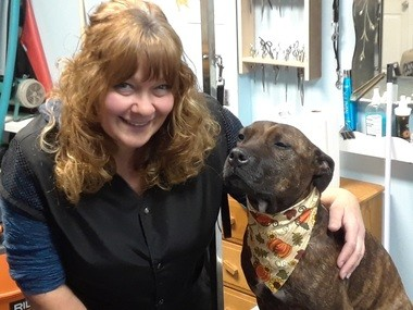 The Pisces Puppy owner Kathy Malto and her rescued pit bull, Pixie. Because there is an abundance of pit bulls in shelters, the business donates $5 for every pit bull it grooms to the City Dogs program of the Cleveland City Kennel.