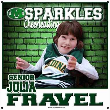 Medina Sparkle, Julia Fravel, has a banner with her photo hanging in the Medina gym. The banner was donated by one of the companies in the community, Your Kids in Action, using a picture taken by Heather Denman Photography. The Sparkle Effect is a national program that encourages schools to include students with disabilities in their cheer or dance squads. (Image courtesy of Your Kids in Action)