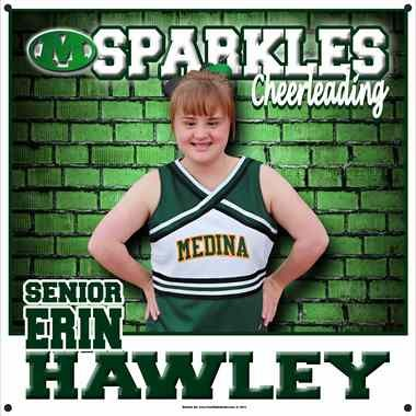 Medina Sparkle, Erin Hawley, has a banner with her photo hanging in the Medina gym. The banner was donated by one of the companies in the community, Your Kids in Action, using a picture taken by Heather Denman Photography. The Sparkle Effect is a national program that encourages schools to include students with disabilities in their cheer or dance squads. (Image courtesy of Your Kids in Action)