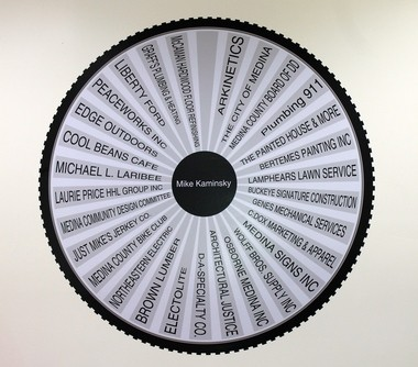 This sign in the Spokes of Medina lounge shows all of the community partners who helped make the idea a reality.