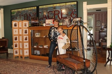 Medina County Historical Society volunteer Katie Palmer thinks the redesigned rooms in the John Smart House museum will make learning about the county's history more inviting for visitors, especially children.