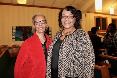"""Cheryl Mason, right, shares a hug with her childhood mentor and """"second mom"""" Dr. Brinca Hunter at last night's Medina County Black History Month program at Second Baptist Church. The two women spoke about their experiences growing up in Medina."""