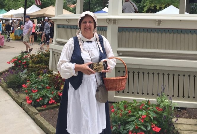 Actress Germaine Wilson, dressed as Mrs. Zenus Hamilton, traversed the Medina Fest on Medina Public Square Aug. 25 to share details of Show Biz theater company's upcoming Spirits of the Past program. (Mary Jane Brewer, special to cleveland.com)