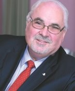 Mike Carlson, longtime educator and funeral home operator