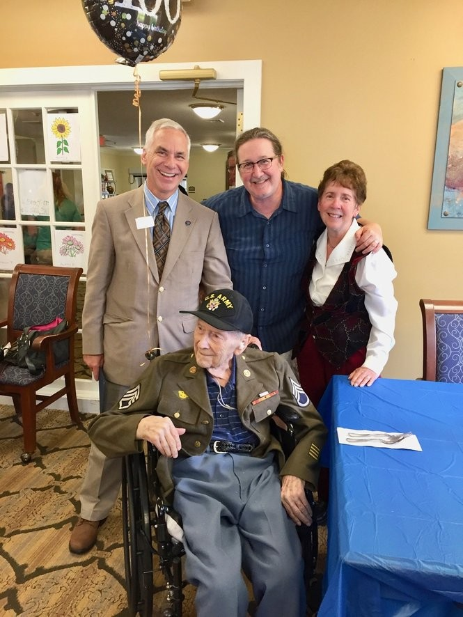 Morris Mersing, front, celebrates his 100th birthday with, from left, Medina Mayor Dennis Hanwell, grandson Gary Blaine and daughter Sherry Blaine. (Mary Jane Brewer, special to cleveland.com)