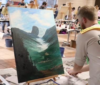 Medina High School Alumni Zach White putting the final touches on his landscape.