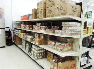 The pantry's interior is spotless and includes multiple refrigerators and freezers, as well as several shelves of fresh and canned foods.