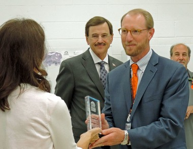 Superintendent Mike Sheppard (right) and Mayor Gary Starr accepted gifts of appreciation from Michele Barbato, president of the food pantry, for their efforts in the pantry's successful relocation.
