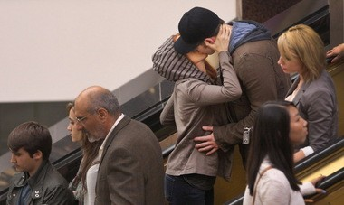 """Scarlett Johansson and Chris Evans steal a smooch during filming of """"Captain America: The Winter Soldier"""" in Cleveland."""