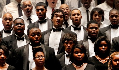 """The Central State University Chorus, in black, and the Martin Luther King Jr. Celebration Chorus, in white, sing the """"Battle Hymn of the Republic"""" at the Martin Luther King Jr. Celebration Concert at Severance Hall Sunday. Tito Munoz conducted the 33rd annual concert in honor of the slain civil rights leader. Before the concert, the Dr. Martin Luther King Jr. Community Service awards were presented by Cleveland Mayor Frank Jackson."""