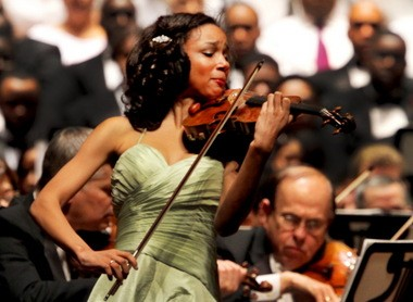 Violinist Ade Williams, 15, plays the first movement of Mozart's Violin Concerto No. 4 in D Major during the 33rd annual Martin Luther King Jr. celebration concert at Severence Hall Sunday evening. Williams is the first-place laureate of the junior division of the 2012 Sphinx Competition.