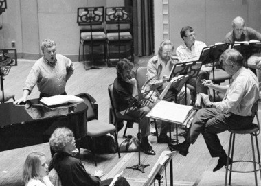 "Former Cleveland Orchestra music director Christoph von Dohnanyi prepares singers for a performance of Henze's ""The Bassards"" in October 1990 at Severance Hall."