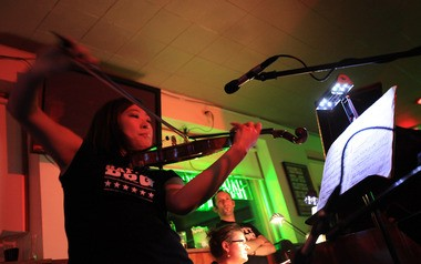Jung-Min Amy Lee, associate concertmaster of the Cleveland Orchestra, performs at the Happy Dog tavern in Oct. 2010. More performances there take place May 14 and 15 as part of a residency in the Gordon Square neighborhood.