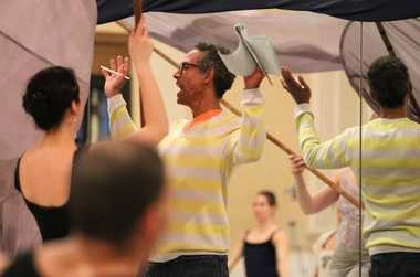 """Choreographer David Rousseve takes members of Dancing Wheels through a rehearsal of his new story ballet, """"Daring to Be Dumbo,"""" which the Cleveland company for dancers with and without disabilities performs this weekend at St. Ignatius High School's Breen Center for the Performing Arts."""