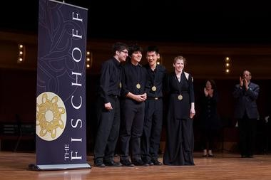 Members of the Omer Quartet celebrate their win Sunday at the Fischoff National Chamber Music Competition.