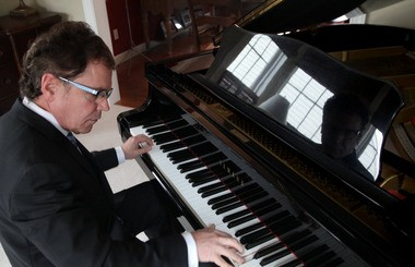 """""""I'm a Slovenian kid. I started playing polkas when I was 5. Then I played classical accordion. I played in state contests at the Statler. It was nerve-racking. I finished second in my age group one year and first another,"""" says musician-attorney Mark Avsec."""