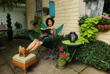 Children's author Marilyn Sadler loves to read on the patio of her Rocky River home.
