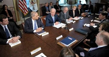 Vice President Joe Biden, center, with Attorney General Eric Holder at left, speaks during a meeting with victims' groups and gun safety organizations in the Eisenhower Executive Office Building on the White House complex in Washington.