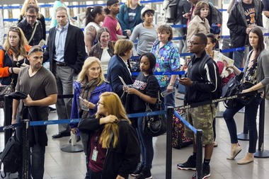 Travelers stand in line at Los Angeles International airport in Los Angeles Monday, April 22. The long lines will be ending as lawmakers rushed a bill through Congress allowing the agency to withdraw furloughs of air traffic controllers and other workers.