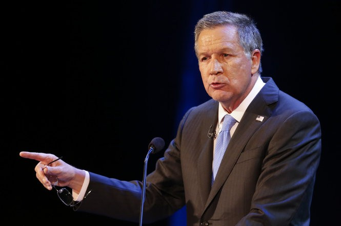 Ohio Gov. John Kasich took some heat Sunday night from the four Republicans looking to succeed him.