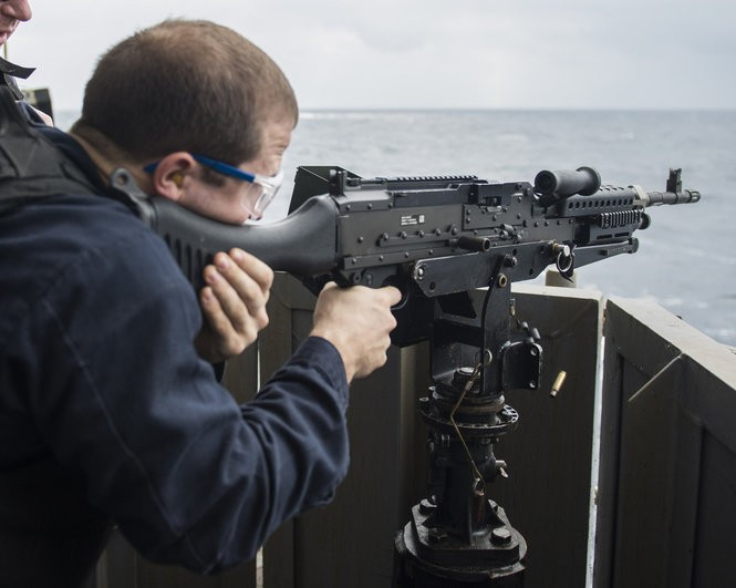 Master-At-Arms 3rd Class Bryon McDonald, from Greeley, Colo., fires an M240B machine gun during a live-fire exercise aboard the amphibious assault ship USS Makin Island.