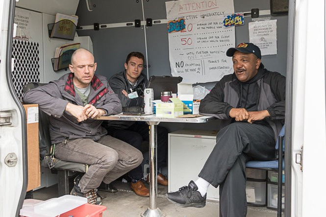 Roger Lowe (left) and Chico Lewis (right) continue to provide support and friendship to drug addicts who regularly visit Circle Health's needle-exchange van on the city's West Side. On a recent day, a medical resident from MetroHealth Hospital (center) joined Lowe and Lewis.