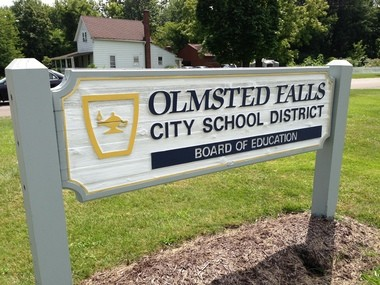 The Olmsted Falls school district has agreed to withdraw a video from the classroom that drew criticisms from a parent and a public-interest law firm.