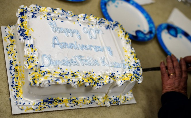 The celebratory cake dons the blue and gold colors of the Bulldog community.