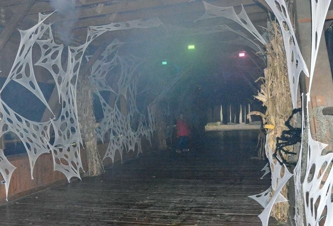 Billowing fog, cobwebs and large spiders on the walls welcome visitors to the Charles A. Harding Memorial Covered Bridge.