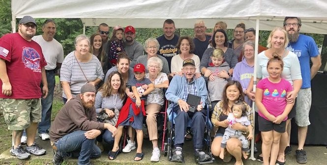Family members attend this year's Falls Day in the Park, where Bill Nickels, seated, was named Citizen of the Year. Photo courtesy of Laura Graham.