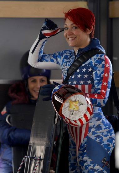U.S. skeleton athlete Katie Uhlaender waves to photographers after a training run Saturday at the Sochi Winter Olympics.