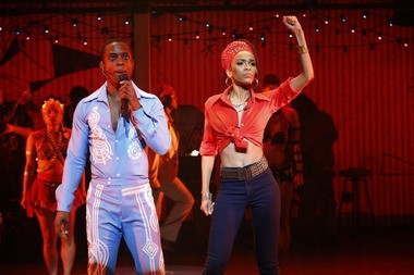 """Michelle Williams as Sandra Isadore and Adesola Osakalumi as Fela Kuti in """"Fela!"""" now onstage at the Palace Theatre in PlayhouseSquare."""