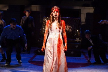 """Caitlin Houlahan as the titular telekinetic heroine in the Beck Center for the Arts production of """"Carrie."""""""