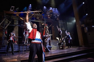 """Actor Kyle Jean-Baptiste (as Enjolras) leads the revolutionary charge in the 2014 Great Lakes Theater production of the Tony Award-winning musical epic """"Les Miserables"""" at the Hanna Theatre."""