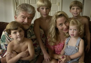 Joe Eszterhas with his wife, Naomi, and their four children in their Bainbridge Township home, Tuesday, Aug. 13, 2002.