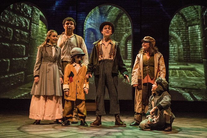 "Pictured from left: Eliza Mayhew, (Miranda Leeann) a girl who hires the diminutive detectives to find her missing grandmother, with Tiny (David Gretchko), Ash (Adler Chefitz), Wiggins (Colin Frothingham) and Pockets (Elise Pakiela). The young actors star in Eric Coble's ""Sherlock Holmes: The Baker Street Irregulars"" at Dobama Theatre."
