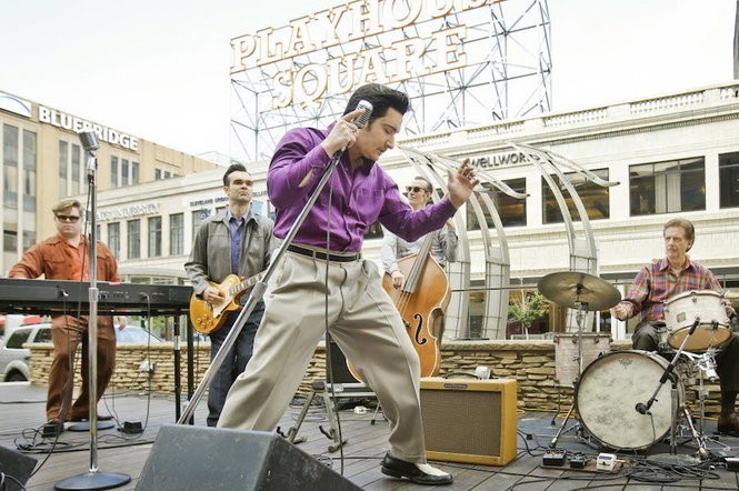 "Tyler K. Hunter puts his hips into his role as Elvis Presley performing with the cast of ""Million Dollar Quartet"" during a free preview of the hit Broadway musical -- featuring the iconic music of Elvis Presley, Jerry Lee Lewis, Johnny Cash, and Carl Perkins -- on Thursday, July 10, 2014 at U.S. Bank Plaza in Playhouse Square. (Lonnie Timmons III/The Plain Dealer)"
