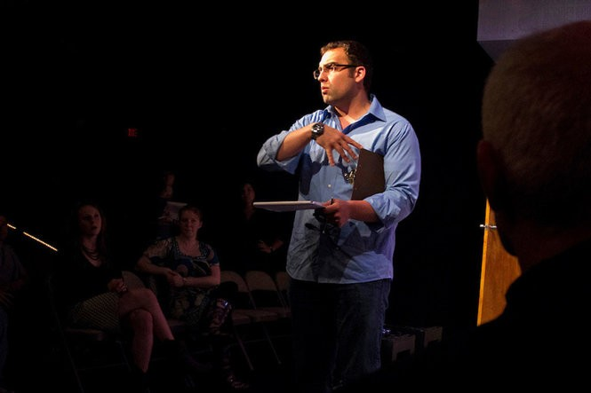 """Nathan Motta gives notes after a rehearsal at Dobama Theatre. In Dobama's 59th season, he'll direct """"John,"""" """"Ella Enchanted"""" and """"This."""" (Photo courtesy of Dobama Theatre)"""