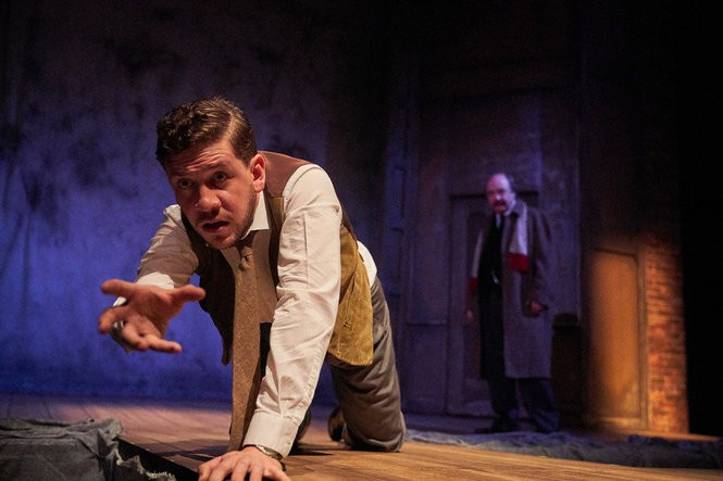 """Adam Wesley Brown (The Actor, in the foreground) and Bradley Armacost (Arthur Kipps) in the chiller """"The Woman in Black"""" at Cleveland Play House. The classic horror fest is the first play of the 2018-19 season. (Roger Mastroianni)"""