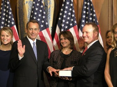 Flanked by family members, Russell Township Republican Rep. Dave Joyce participates in a swearing-in re-enactment with House Speaker John Boehner. Joyce's wife, Kelly, is between them. Flanked by family members, Russell Township Republican Rep. Dave Joyce participates in a swearing-in re-enactment with House Speaker John Boehner. Joyce's wife, Kelly, is between them. Flanked by family members, Russell Township Republican Rep. Dave Joyce participates in a swearing-in re-enactment with House Speaker John Boehner. Between them is Joyce's wife, Kelly.