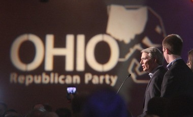 Rob Portman celebrates his election to the U.S. Senate in 2010, a giant Ohio Republican Party logo to his right. Conservatives are bashing Portman and other establishment Republicans for recent moves, including their endorsement of Matt Borges as the state party's next chairman and Portman's reversal in favor of gay marriage.